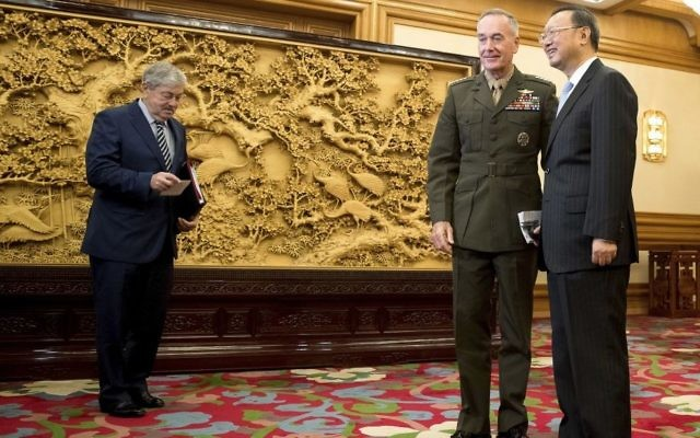 US Chairman of the Joint Chiefs of Staff, Marine Corps Gen. Joseph Dunford , second from right, accompanied by US Ambassador to China Terry Branstad, left, meets with China's State Counselor Yang Jiechi at the Zhongnanhai Leadership Compound in Beijing, China, August 17, 2017. (AP/Andrew Harnik)