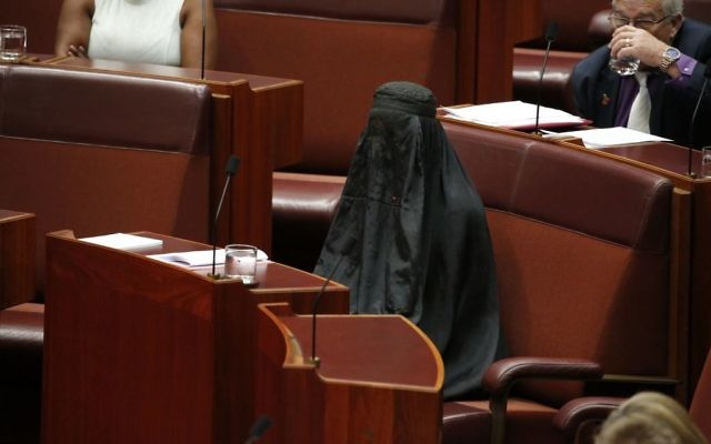 Senator Pauline Hanson wears a burqa during question time in the Senate chamber at Parliament House in Canberra, Australia, Thursday, Aug. 17, 2017. (Jed Cooper/Australian Broadcasting Corp. via AP)