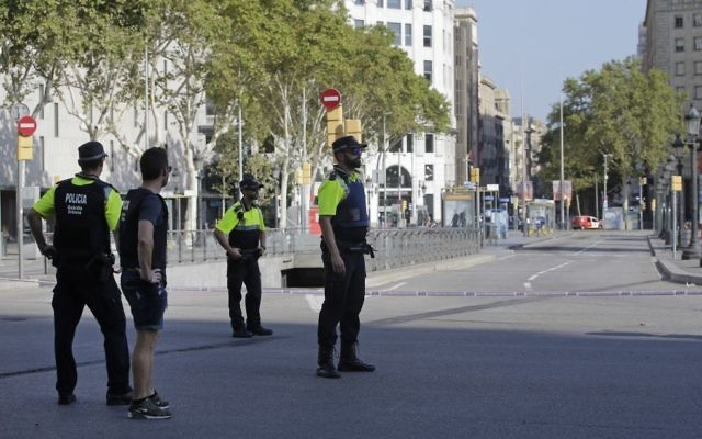 Police officers cordon off a street in Barcelona, Spain, Thursday, Aug. 17, 2017, following a terror attack. (AP Photo/Manu Fernandez)