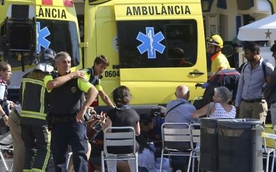 Injured people are treated after a van jumped the sidewalk of the Las Ramblas Boulevard in Barcelona, Spain, on Thursday, August 17, 2017. (AP/Oriol Duran)