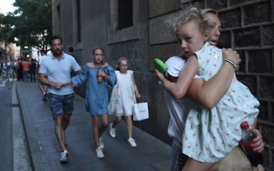 People flee the scene in Barcelona, Spain, Thursday, Aug. 17, 2017 after a white van jumped the sidewalk in the historic Las Ramblas district, crashing into a summer crowd of residents and tourists. (AP Photo/Giannis Papanikos)