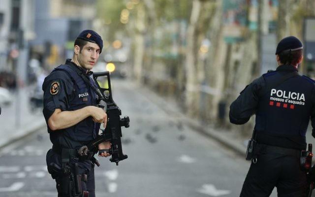Armed police officers patrol a deserted street in Las Ramblas, in Barcelona, Spain, Friday, August 18, 2017. (AP/Manu Fernandez)