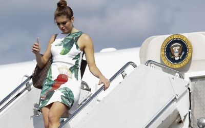 In this photo taken June 30, 2017, Hope Hicks arrives on Air Force One at Morristown Municipal Airport, in Morristown, N.J., en route to Trump National Golf Club in Bedminster, New Jersey. (AP Photo/Carolyn Kaster)