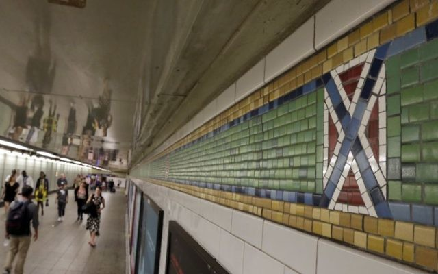 "A mosaic tile design meant to represent Times Square's status as the ""Crossroads of the World"" is part of the subway station's border, in New York, Friday, Aug. 18, 2017. Transit officials have decided to alter subway tiles at the station that have a design that's been compared to the Confederate flag, to make it ""crystal clear"" that they don't depict the flag. (AP Photo/Richard Drew)"