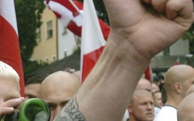 In this file photo dated Saturday, Aug. 21, 2004, Neo-Nazi sympathizers demonstrate prior to the beginning of a commemoration march for Adolf Hitler's deputy Rudolf Hess in the northeastern Bavarian town of Wunsiedel where Hess was buried. (AP Photo/FILE)