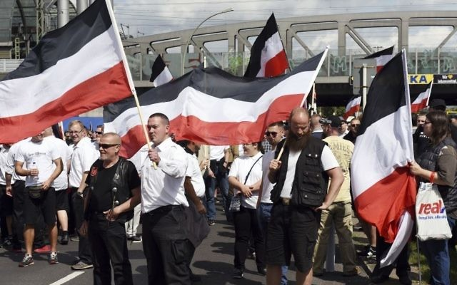 Far-right extremists gather to commemorate the death of Adolf Hitler's deputy, Rudolf Hess, in Berlin's western district of Spandau, Saturday, Aug. 19, 2017. (Maurizio Gambarini/dpa via AP)