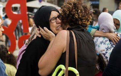 Families of young men believed responsible for the attacks in Barcelona and Cambrils gather along with members of the local Muslim community to denounce terrorism and show their grief in Ripoll, north of Barcelona, Spain on August 19, 2017. (AP Photo/Francisco Seco)