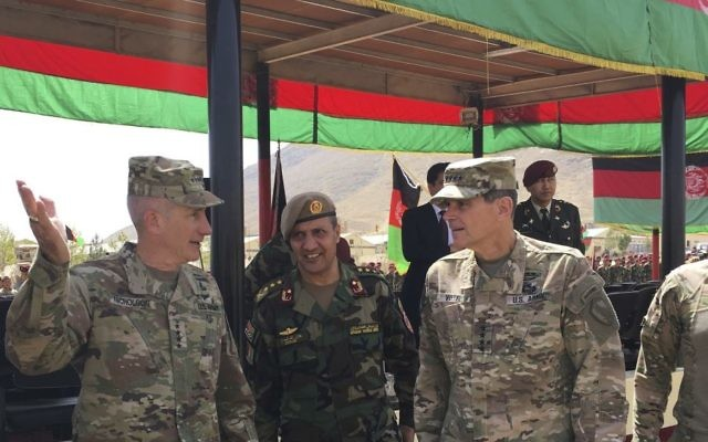 U. Gen. John Nicholson, top US commander in Afghanistan, left, talks with Col. Khanullah Shuja, commander of the national mission brigade of the Afghan special operations force, and US Gen. Joseph Votel, head of U. Central Command, at Camp Morehead in Afghanistan, Aug. 20, 2017. (Photo/Lolita Baldor)