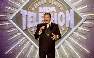 Entertainer Jerry Lewis makes his opening remarks at the 25th Anniversary of the Jerry Lewis MDA Labor Day Telethon fundraiser in Los Angeles, September 2, 1990. (AP Photo/Julie Markes/File)
