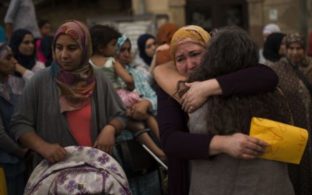 Members of the local Muslim community gather along with relatives of young men believed responsible for the attacks in Barcelona and Cambrils to denounce terrorism and show their grief in Ripoll, north of Barcelona, Spain, Sunday Aug. 20, 2017. (AP Photo/Francisco Seco)