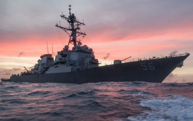In this Jan. 22, 2017, photo provided by US Navy, the USS John S. McCain conducts a patrol in the South China Sea while supporting security efforts in the region. (James Vazquez/US Navy via AP)