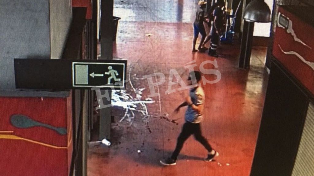In this watermarked frame grab from CCTV released by the Spanish newspaper El Pais on Monday Aug. 21, 2017, a suspect. believed to be Younes Abouyaaqoub is is captured by a security camera walking through La Boqueria market seconds after a van crashed into pedestrians in Barcelona last August 17. (EL Pais, via AP)