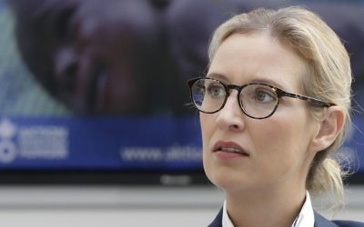 In this Aug. 21, 2017 photo, Alice Weidel, co-top candidate of the German AfD (Alternative for Germany) party for the upcoming general elections, awaits a press conference in Berlin, Germany. (AP Photo/Michael Sohn)