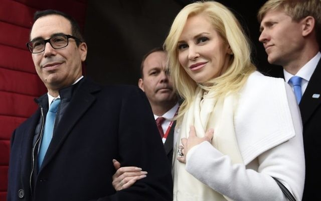 In this January. 20, 2017 photo, then Treasury Secretary-designate Stephen Mnuchin and his then-fiancee, Louise Linton, arrive on Capitol Hill in Washington, for the presidential inauguration of Donald Trump. (Saul Loeb/Pool Photo via AP, File)