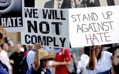 People protest outside the Phoenix Convention Center as US President Donald Trump holds a rally inside, August 22, 2017. (AP Photo/Matt York)