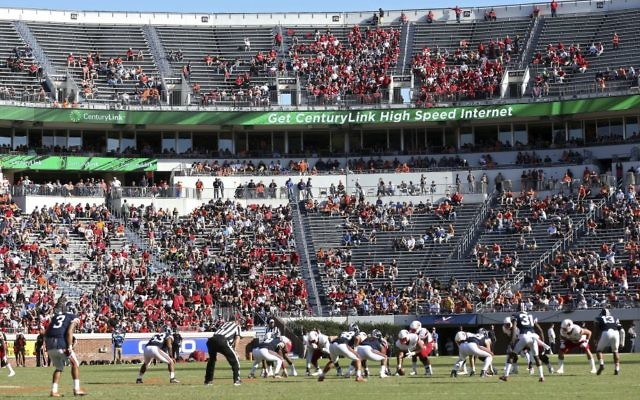 In this Oct. 29, 2016, file photo, Louisville lines up for a play against Virginia during an NCAA college football game in Charlottesville, Virginia. (AP Photo/Ryan M. Kelly, File)