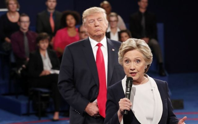 Then-Democratic presidential nominee Hillary Clinton speaks as then-Republican presidential nominee Donald Trump listens during the second presidential debate at Washington University in St. Louis, October 9, 2016. (Rick T. Wilking/Pool via AP)