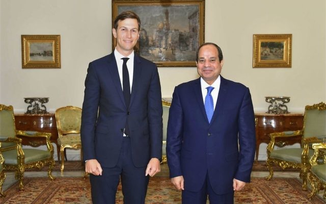 Egypt's President Abdel-Fattah el-Sissi, right, poses for a photo with White House adviser Jared Kushner, in Cairo, Egypt, Wednesday, Aug. 23, 2017. (MENA via AP)