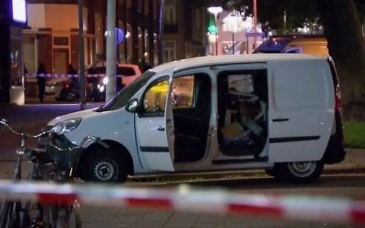 In this image taken from video a van is examined behind a cordoned-off area in Rotterdam on August 23, 2017.  (RTL via AP)