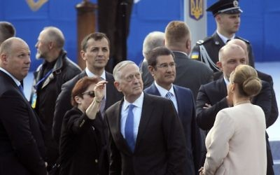 US Defense Secretary Jim Mattis, center, attends a military parade to celebrate independence day in Kiev, Ukraine, Thursday, Aug. 24, 2017. (AP Photo/Efrem Lukatsky)