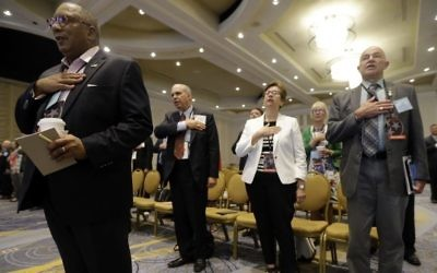 People stand for the Pledge of Allegiance during a meeting of the standing committee on rules at the Republican National Committee summer meeting, Thursday, Aug. 24, 2017, in Nashville, Tenn. (Mark Humphrey/AP)