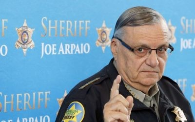 In this Dec. 18, 2013, file photo, Maricopa County Sheriff Joe Arpaio speaks at a news conference at the Sheriff's headquarters in Phoenix, Arizona. (AP Photo/Ross D. Franklin, File)