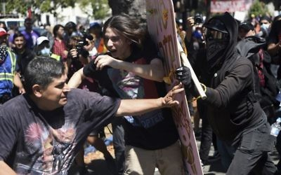 Demonstrators clash during a free speech rally Sunday, Aug. 27, 2017, in Berkeley, Calif. (AP Photo/Josh Edelson)
