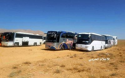 This photo provided on Monday, Aug 28, 2017 by the government-controlled Syrian Central Military Media, shows buses gathering before a planned evacuation of Islamic State group militants, in the mountainous region of Qalamoun, Syria. (Syrian Central Military Media, via AP)