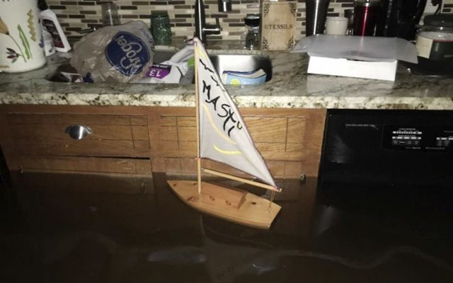 This Sunday, August 27, 2017, photo provided by Ramit Plushnick-Masti, shows a toy sailboat floating in the kitchen of her flooded home in Houston's Meyerland neighborhood. (Ramit Plushnick-Masti via AP)