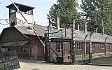 This file photo from July 29, 2016, shows the main gate of the former German Nazi death camp of Auschwitz, Poland. (AP Photo/Czarek Sokolowski)