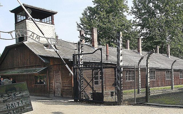 This July 29, 2016, file photo shows the main gate of the former German Nazi death camp of Auschwitz, Poland. (AP Photo/Czarek Sokolowski)