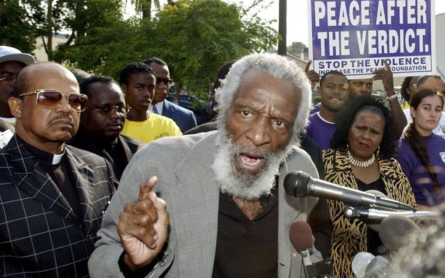 Dick Gregory talks at a Peace Vigil outside City Hall in Inglewood, California, July 29, 2003. (AP Photo/Reed Saxon)