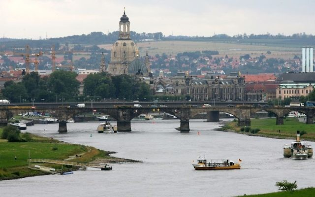 This July 31, 2007 file photo shows a general view to the river Elbe and the old town district of Dresden, eastern Germany.  The area, including the imposing Frauenkirche (center) was completely destroyed by Allied bombing in 1945. (AP photo/Matthias Rietschel)