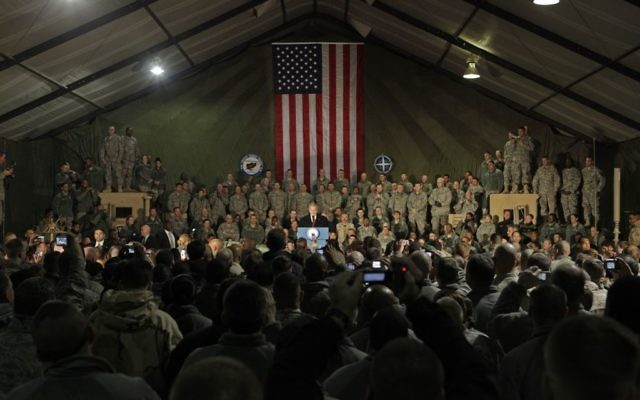 President George W. Bush talks with US troops, December 14, 2008 at Bagram Air Base, Afghanistan. (AP Photo/Evan Vucci)