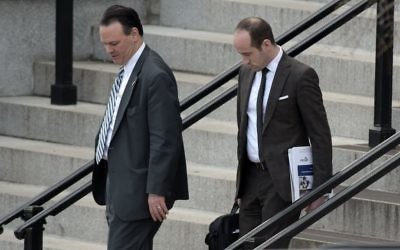 Trump deputy chief of staff for policy, Rick Dearborn, left, and senior policy adviser Stephen Miller, right, walk down the steps of the Eisenhower Executive Office Building on the White House complex in Washington, Friday, January 13, 2017. (AP Photo/Susan Walsh)