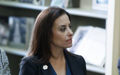 Dina Powell, US President Donald Trump's senior counselor for economic initiatives, listens during a meeting between the president and business leaders in the White House, April 11, 2017. (AP Photo/Evan Vucci, File)