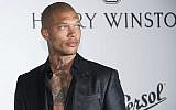 Jeremy Meeks poses for photographers upon arrival at the amfAR charity gala during the Cannes 70th international film festival, Cap d'Antibes, southern France, Thursday, May 25, 2017 (Arthur Mola/Invision/AP)