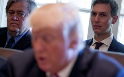 White House senior advisers Steve Bannon, left, and Jared Kushner, listen as US President Donald Trump speaks during a cabinet meeting, June 12, 2017, in the Cabinet Room of the White House in Washington. (AP Photo/Andrew Harnik)
