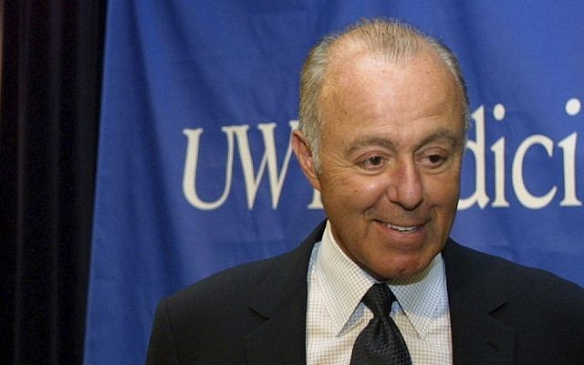In this April 24, 2003, photo, Jeff Brotman, Chairman of Costco Wholesale Corporation, speaks during a news conference at the University of Washington in Seattle. (AP Photo/Ralph Radford)