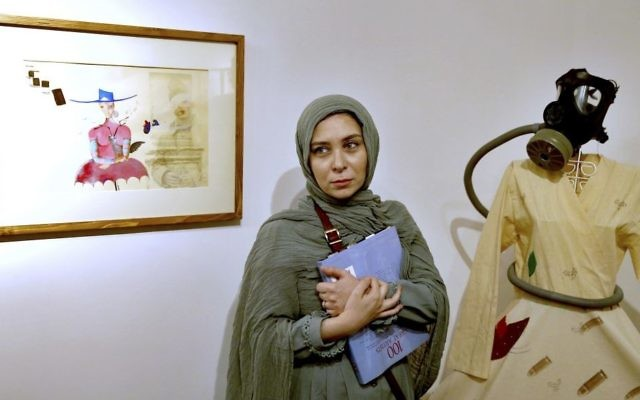 Narges Mousavi, an Iranian artist and daughter of Mir Hossein Mousavi, stands during her exhibition in 'House of Free Designers' art gallery in Tehran, Iran, Friday, Aug. 11, 2017. (Ebrahim Noroozi/AP)