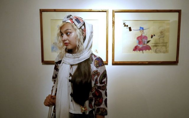 "An Iranian woman attends a painting exhibition of Narges Mousavi in ""House of Free Designers"" art gallery in Tehran, Iran, Friday, Aug. 11, 2017. (Ebrahim Noroozi/AP)"