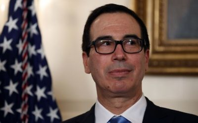 Treasury Secretary Steve Mnuchin stands in the Diplomatic Reception Room of the White House in Washington, Monday, Aug. 14, 2017, during an event for President Donald Trump to sign a memorandum calling for a trade investigation of China. (AP Photo/Alex Brandon)