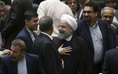 Iranian President Hassan Rouhani (C) leaves the parliament after proposing his new cabinet, in Tehran, Iran, August 15, 2017. (AP Photo/Vahid Salemi)