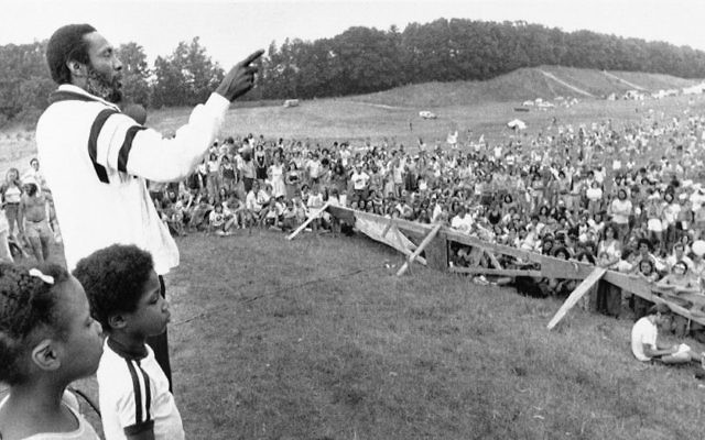 Dick Gregory stands onstage before a crowd of some 4,500 anti-nuclear protesters gathered in Seabrook, New Hampshire, July 23, 1979 . (AP Photo/Tim Savard/FILE)