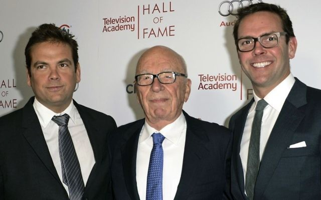 In this March 11, 2014 file photo, News Corp. Executive Chairman Rupert Murdoch, center, and his sons, Lachlan, left, and James Murdoch attend the 2014 Television Academy Hall of Fame in Beverly Hills, California. (Photo by Dan Steinberg/Invision/AP Images)
