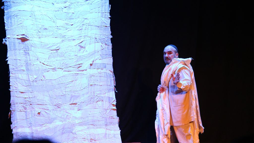 The actor Yishai Meir in a Fringe Theater performance at Beit Mazia. (Shmuel Bar-Am)