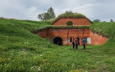 A film crew preparing to record at the former concentration camp known as the Seventh Fort in Kaunas, Lithuania, on July 12, 2016. (JTA/Cnaan Liphshiz)