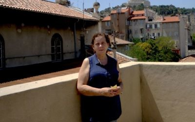 Martine Yana, director of the Edmond Fleg Center in Marseille, France, standing on its terrace roof, July 10, 2017. (Cnaan Liphshiz/JTA)