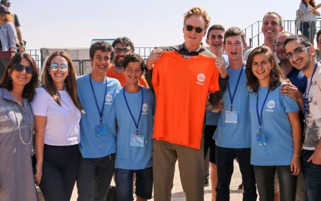 Conan O'Brien, with the Orange T-shirt, meets participants of the Tower of David Museum Hackathon in Jerusalem, Aug. 28, 2017; Elat Lieber, director of the Tower of David Museum, is at the far left (Courtesy: Ricky Rachman)