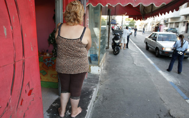 A female prostitute stands outside a brothel in south Tel Aviv, looking at a policewoman nearby, September 21, 2008. (Kobi Gideon / FLASH90)